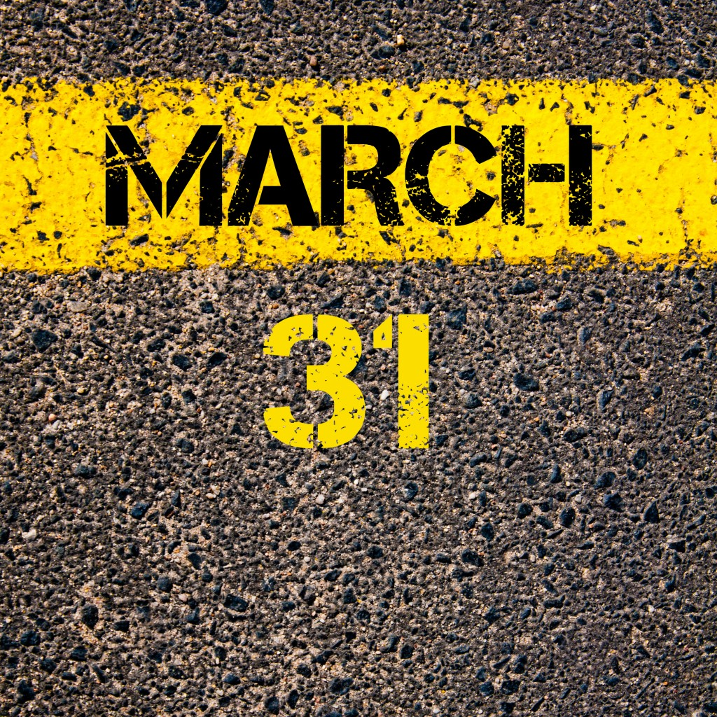 31 March calendar day over road marking yellow paint line