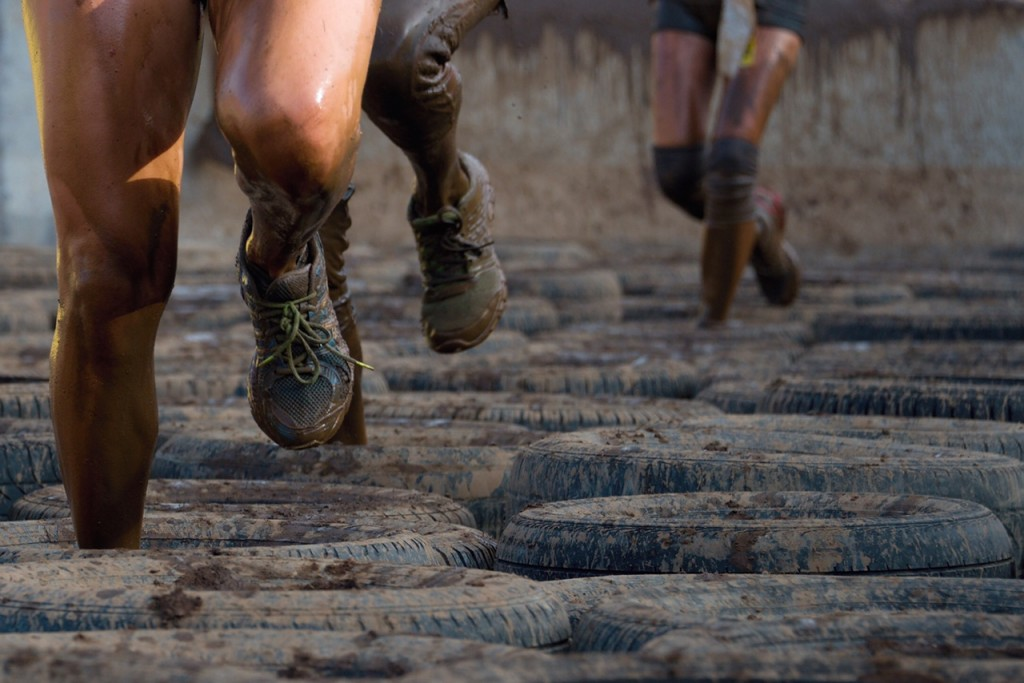 Mud race runners, tries to make it through the tire trap